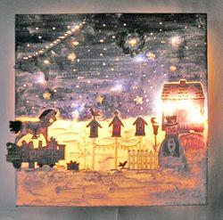 Haus im Schnee, im Dunkeln mit Beleuchtung